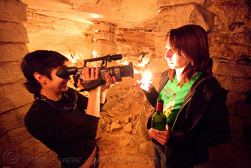 catacombes de paris - catacombs of paris (off-limit area) - alyssa and coraline, androgynous, camcorder, camera, candles, cataphile, cave, new year's eve, new year's eve 2008, people, shooting, underground quarry, video, video camera, woman