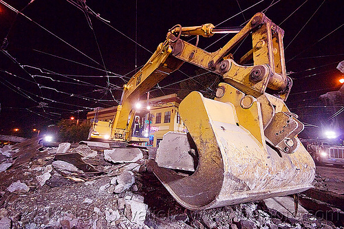 caterpillar 326L excavator, at work, bucket attachment, cat 326l, demolition, excavator bucket, light rail, muni, night, ntk, overhead lines, pavement, railroad construction, railroad tracks, railway tracks, san francisco municipal railway, track maintenance, track work, working