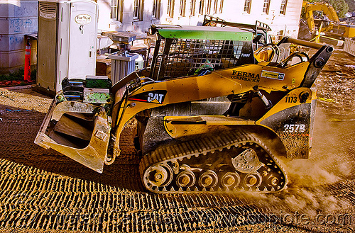caterpillar CAT 257B tracked skid steer loader - multi terrain loader, abandoned building, abandoned hospital, building demolition, cat 257b, caterpillar 257b, front loader, multi terrain loader, presidio hospital, presidio landmark apartments, skid steer loader