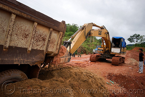 caterpillar CAT E200B excavator - truck getting a lift from an excavator (laos), at work, cat e200b, caterpillar e200b, dirt road, excavator, heavy equipment, hydraulic, lorry, machinery, mud, ruts, stuck, tracks, truck, unpaved, working