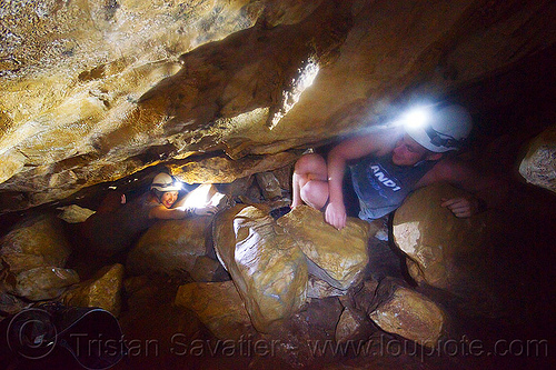 cavers in a squeeze - caving in mulu (borneo), cavers, caving, clearwater cave system, clearwater connection, gunung mulu national park, natural cave, spelunkers, spelunking, squeeze