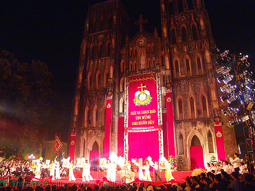 celebration in front of the cathedral - vietnam, cathedral, church, hanoi, red, vietnam