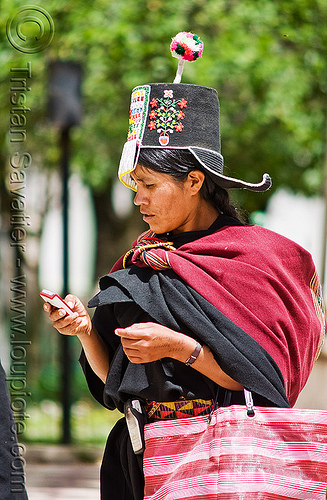 cellphone used by tribe - (bolivia), bolivia, cellphone, hat, indigenous, pom-poms, pom-pons, quechua, tarabuco, woman