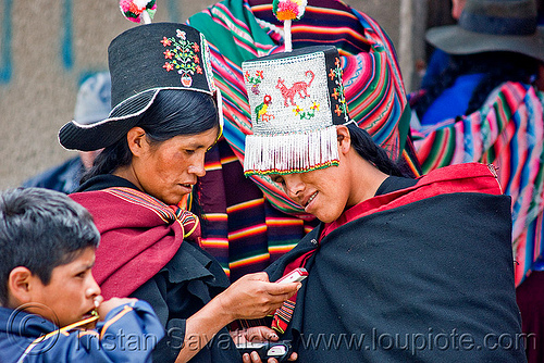 cellphone used by tribe women, cellphones, hats, headdress, headwear, indigenous, phones, quechua, tarabuco, technology, traditional, tribal, tribe, women