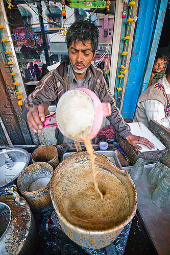 chai stall - preparing chai, boiling, chai stall, chai wallah, cooking, delhi, india, man, milk tea, paharganj, sift, spice tea, stove, street food, street seller, street vendor, tea stall