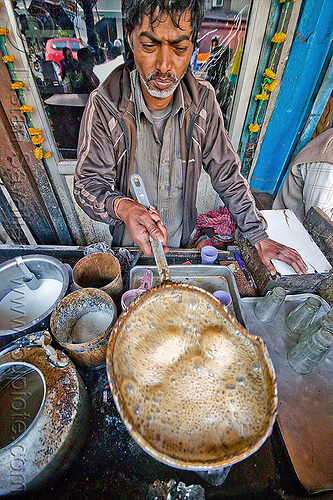 chai wallah boiling chai, boiling, bubbles, bubbling, chai stall, chai wallah, cooking, delhi, india, man, milk tea, paharganj, spice tea, stove, street food, street seller, street vendor, tea stall
