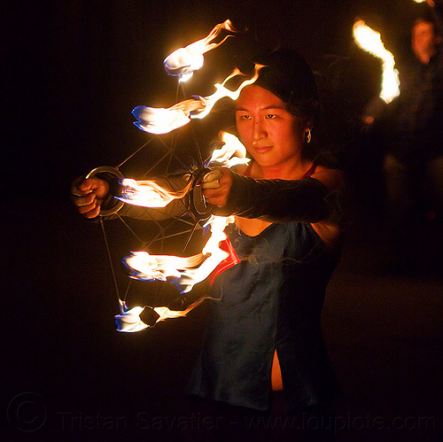 chinese woman spinning fire fans - mel, fire dancer, fire dancing, fire fans, fire performer, fire spinning, hands, mel, night, woman