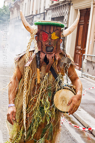 choukaj at the carnaval tropical de paris, caribbean, carnaval tropical, carnival, chain, choukaj, costumes, creole, créole, drum, festival, guadeloupe, horns, indigenous culture, man, mask, masked, parade, paris, traditional, tribal, west indies