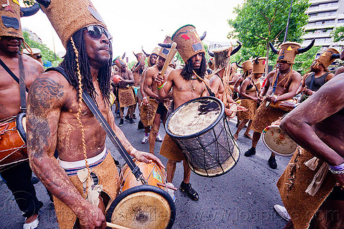 choukaj at the carnaval tropical de paris, caribbean, carnaval tropical, carnival, choukaj, costumes, creole, crowd, créole, drummers, drums, festival, guadeloupe, hat, horns, indigenous culture, men, parade, paris, traditional, tribal, west indies