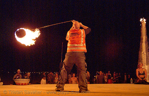 chris (controlled burn of reno) on the shiva vista stage - burning man 2007, burning man, chris, controlled burn, fire performer, fire spinning, night, shiva vista stage, spinning fire