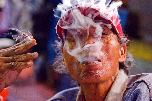 cigarette smoking, cap, cigarette, exhaling, hand, java, jogja, jogjakarta, malioboro, man, night, rickshaw driver, smoke, smoker, smoking, yogyakarta