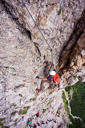 cliff climbing in the dolomites - via ferrata, alps, cliff, climber, climbing harness, climbing helmet, dolomites, dolomiti, ferrata tridentina, mountain climbing, mountaineer, mountaineering, mountains, people, rock climbing, vertical, via ferrata brigata tridentina, woman
