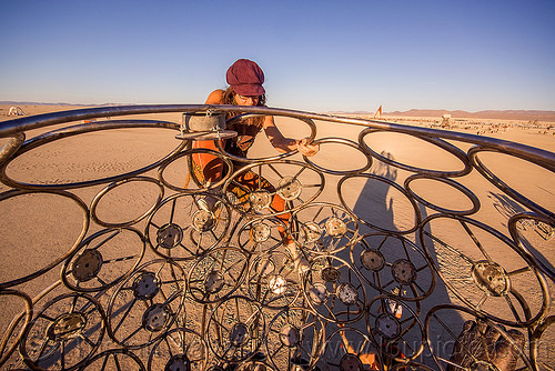 climbing brainchild cage - burning man 2015, art installation, brainchild, cage, metal, michael christian, rings, sculpture