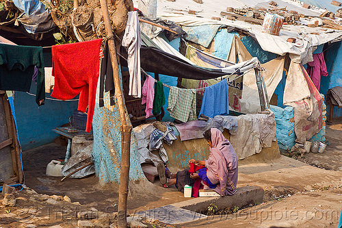 cloth lines (india), cloth lines, india, shanty house, shanty town, single story house, sitting, village, woman