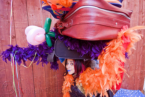 clown act, balloons, blue lipstick, circus artist, feather boa, luggage, mumu, party balloons, people, performer, props, suitcases, woman