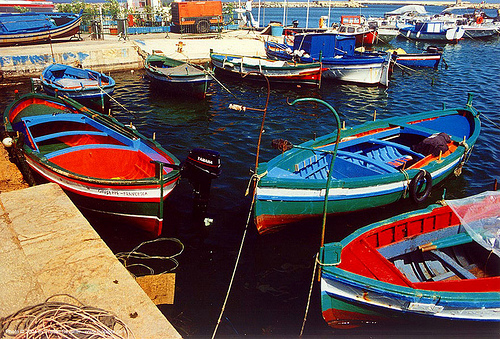 colorful small fishing boats moored in harbor, mooring, pier, sicily, siracusa, siracuse, small boats