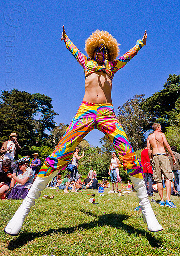 colorful woman jumping, afro hair, bay to breakers, festival, footrace, golden gate park, jump, jumpshot, long legs, street party, turf, woman