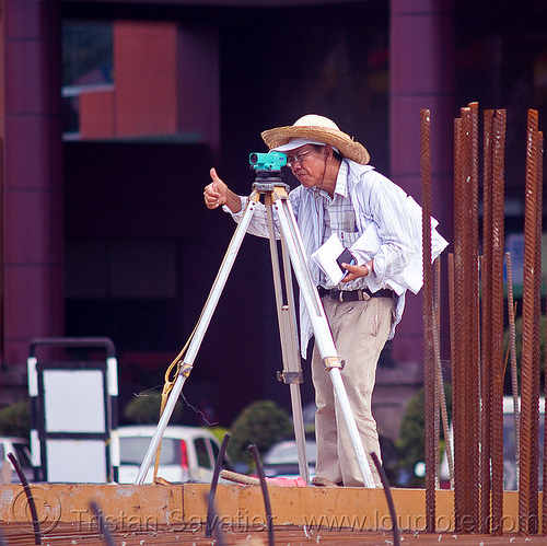 construction surveying - theodolite - tripod, building construction, construction site, construction surveying, construction surveyor, construction workers, geometer, man, miri, people, rebars, standing, straw hat, sun hat, survey, theodolite, thumb up, tripod, working