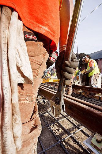 construction worker holding a wrench, construction workers, duboce, hand, light rail, men, muni, ntk, railroad construction, railroad tracks, railway tracks, san francisco municipal railway, track maintenance, track work, workshop rag, wrench