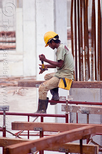 construction worker on shoring scaffolding, building construction, construction site, construction workers, hammer, lumber, man, miri, rebars, safety helmet, scaffolding, shoring, sitting, timber