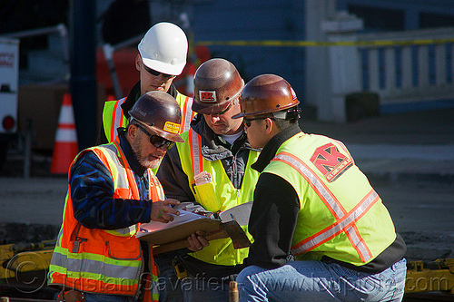 construction workers checking the project blueprint, blueprint, construction workers, duboce, foreman, foremen, high-visibility jacket, high-visibility vest, light rail, men, muni, ntk, railroad construction, railroad tracks, rails, railway tracks, reflective jacket, reflective vest, safety helmet, safety vest, san francisco municipal railway, surveyors, track maintenance, track work, working