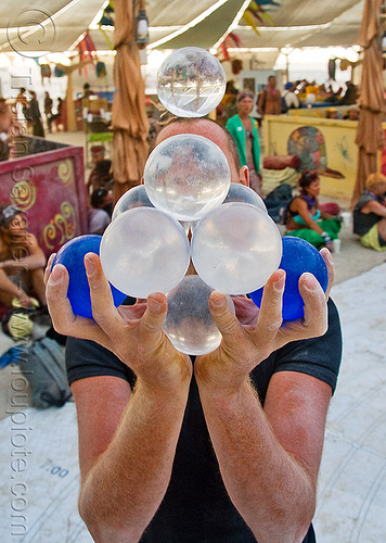 contact juggling balls, burning man, contact juggler, contact juggling, juggling balls, ludovic, mister om