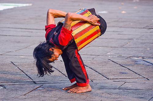 contortionist, contortionist, eid ul-fitr, fatahillah square, jakarta, java, man, street performer, taman fatahillah