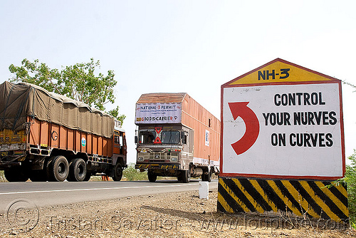 control your nurves on curves (sic!) - road sign (india), curves, highway, india, lorry, nerves, nh-3, nurves, red arrow, road marker, road sign, traffic, trucks, turn