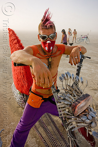 cool burner with mohawk and spoon fish bike - eric - burning man 2009, art car, burning man, dust mask, fish bike, goggles, mohawk hair, motorbike, motorcycle, respirator, rider, riding, spoon bike, spoon scooter, spoons