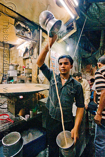 cooling the milk - cooked milk street vendor - delhi (india), boy, cooked milk, delhi, garam doodh, market, night, paharganj, pot, pouring, street, vessel