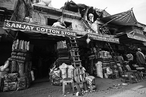 cotton stores in paharganj (delhi, india), building, cotton stores, delhi, dilapidated, handloom store, india, khurana handloom & cotton store, ladders, paharganj, sanjay cotton store, shops