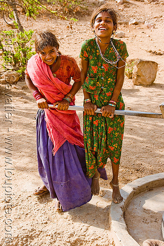 country girls pumping water with hand pump, handle, people, saris, two, udaipur, water pump