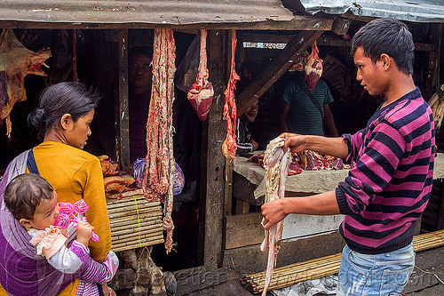 couple buying beef organs at meat market (india), baby, beef, child, east khasi hills, india, kid, man, meat market, meat shop, meghalaya, pynursla, raw meat, toddler, woman