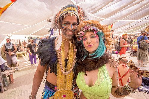 couple - center camp - burning man 2015, costume, feathers, headdress, necklace, people, tribal, tribal costume, woman