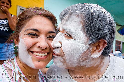 couple covered with white talk powder - carnaval - carnival in jujuy capital (argentina), andean carnival, kiss, kissing, man, noroeste argentino, people, san salvador de jujuy, woman