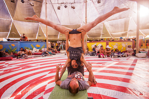 couple doing acro-yoga - burning man 2015, acro-yoga, azami, burning man, leg spread, legs spread, splits, spread eagle, upside down, woman