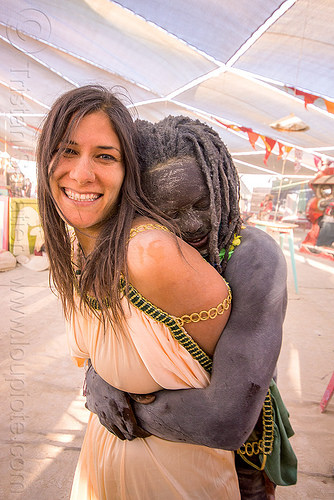 couple hugging - burning man 2015, african, burning man, center camp, couple, hugging, woman