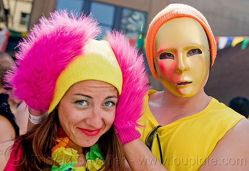 couple in yellow and pink party costumes - how weird festival (san francisco), clothing, fashion, fuzzy gloves, golden mask, kandi kid, kandi raver, man, pink, woman, yellow