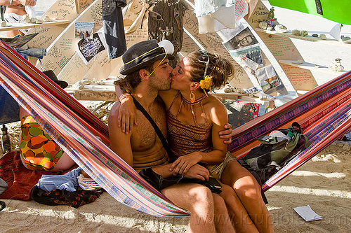 couple kissing on hammock in temple - burning man 2013, burning man, hammock, inside, interior, kiss, kissing, lovers, making out, mementos, temple of whollyness, woman