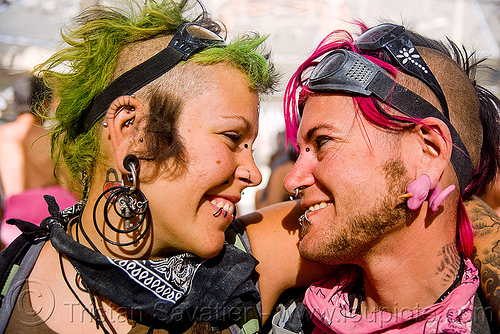 couple - lovers - burning man 2009, burning man, chance flash lightning, ear piercing, goggles, green, jewelry, pink, sky nebeulah, woman