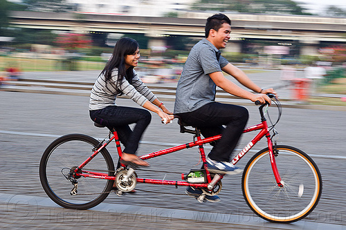 couple on tandem, couple, family, jakarta, java, man, medan merdeka, merdeka square, moving, park, riding, road, tandem bicycle, tandem bike, woman