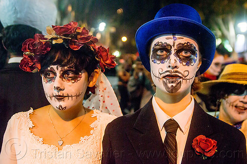 couple with sugar skull makeup - dia de los muertos (san francisco), day of the dead, dia de los muertos, face painting, facepaint, flower headdress, flowers, halloween, hat, night, sugar skull makeup, women
