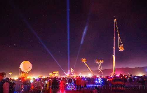 cranes and cherry pickers - burning man 2015, cherry picker, crane, crowd, glowing, lasers, night, scissor lift