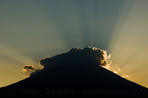 crepuscular rays on gunung agung volcano at sunset, backlight, bali, clouds, haze, hazy, mountains, silverlining, stratovolcano, sun rays