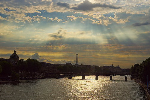 crepuscular rays over paris - river seine, backlight, bridge pillars, cloudy sky, crepuscular rays, eiffel tower, paris, passerelle des arts, pont des arts, river, seine, sun light, sun rays through clouds