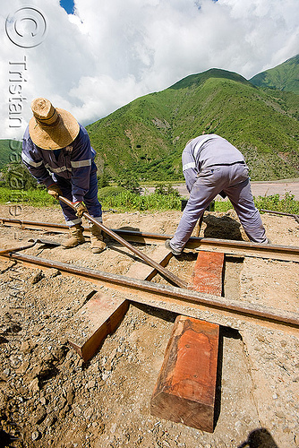 crew replacing a wood railroad tie, men, metric gauge, narrow gauge, noroeste argentino, railroad construction, railroad ties, railroad tracks, rails, railway sleepers, railway tracks, single track, track maintenance, tren a las nubes, workers, working