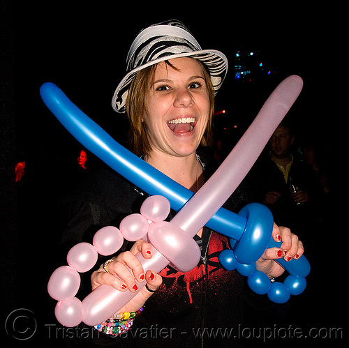 cross swords - NYE 2009 party at somarts (san francisco), clown balloons, cross swords, hat, new year's eve, sabres, woman