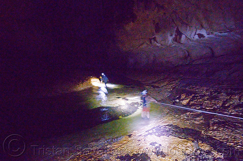 crossing underground river - caving in mulu (borneo), cavers, caving, clearwater cave system, clearwater connection, clearwater river, fording, gunung mulu national park, natural cave, river cave, river crossing, rope, spelunkers, spelunking, underground river, wading, water