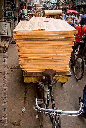 cycle rickshaw loaded with sheets of printed paper (india), delhi, jayyed press, print shop, printed paper, printed sheets, printing shop, tibetan prayers