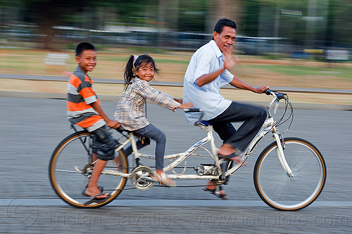 dad and kids riding tandem bicycle, boy, children, family, father, jakarta, java, kids, little girl, man, medan merdeka, merdeka square, moving, park, riding, road, tandem bicycle, tandem bike
